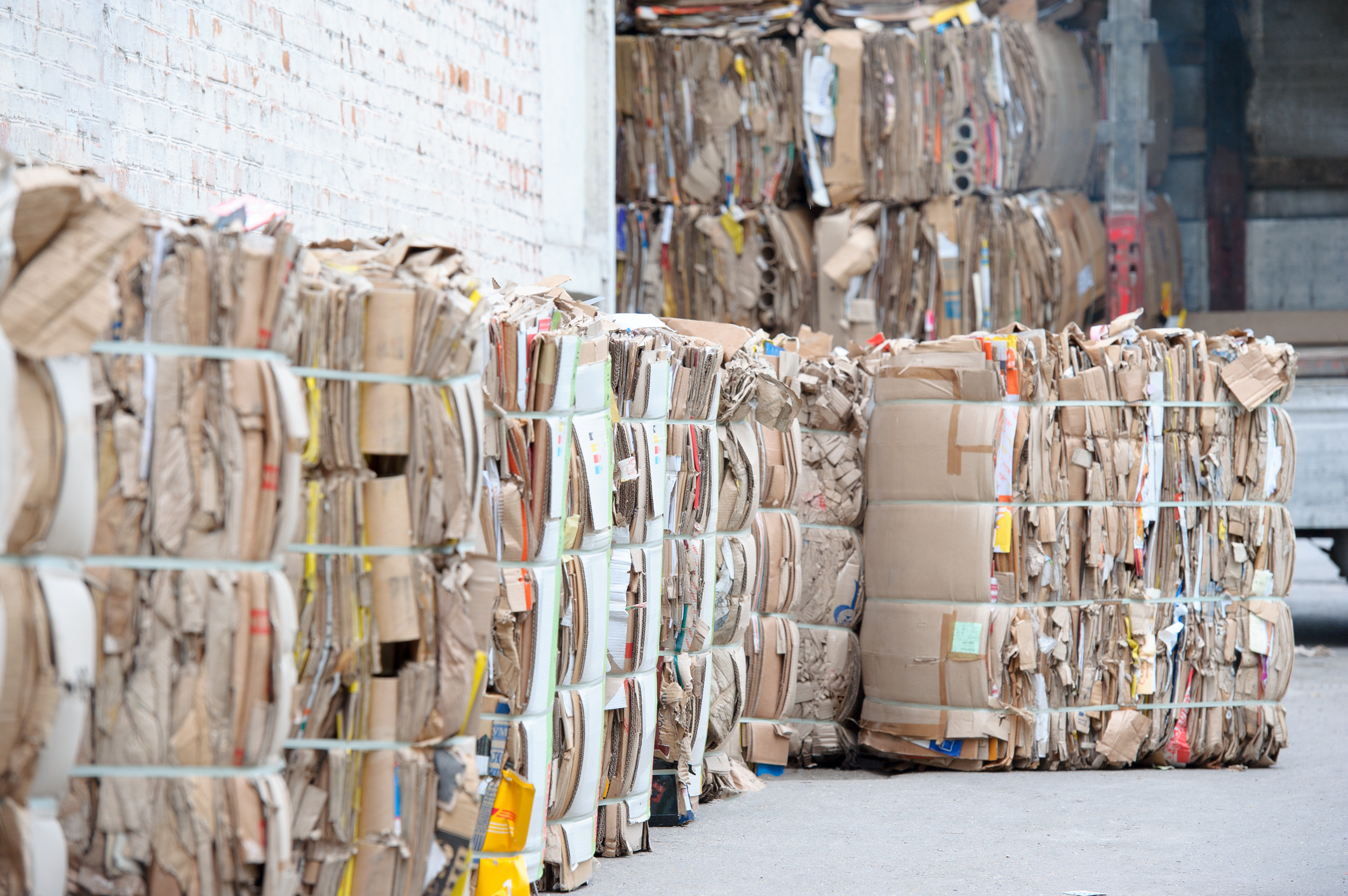 waste paper is collected and packed for recycling. Cardboard and Paper Recycling.